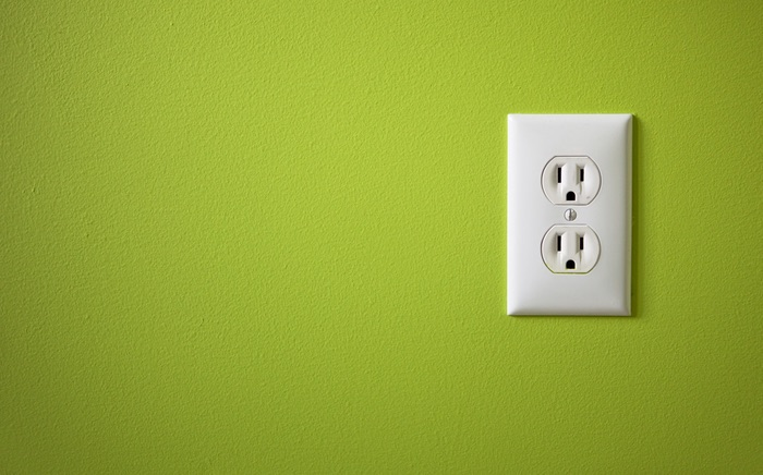 Unseen ants inside an electrical outlet